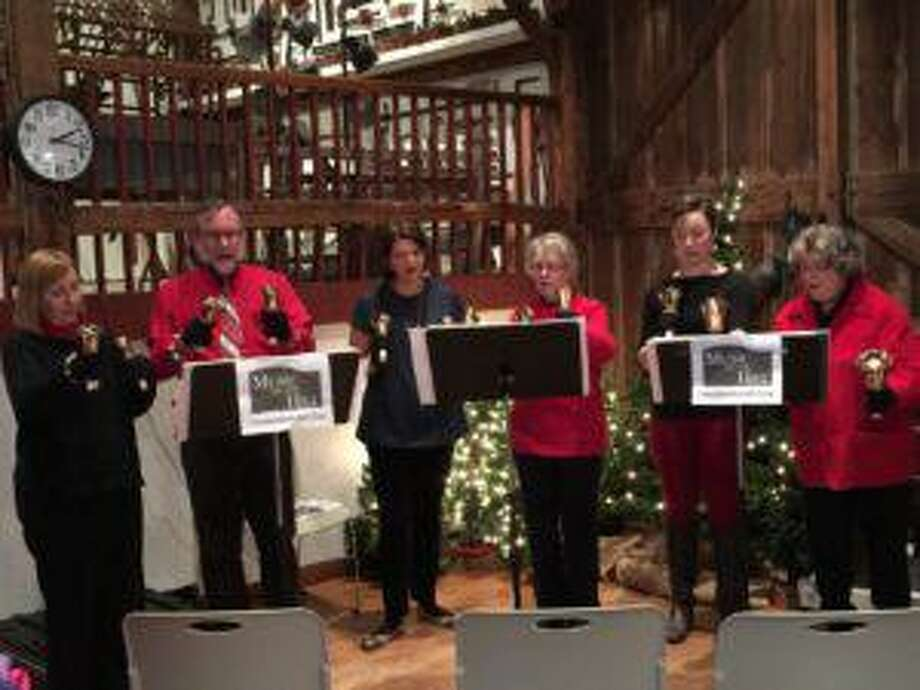 Music on the Hill, with their cheerful hand bells and holiday songs, will be at the Wilton Historical Society for a Songs with Santa event Dec. 21. Photo: Wiltonhistorical.org
