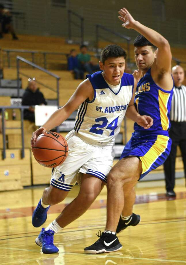 Sophomore guard Diego Romo is averaging 8.1 points, 4.7 assists and four rebounds per game this season for St. Augustine. Photo: Danny Zaragoza /Laredo Morning Times
