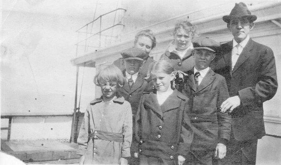 Family all dressed up for a trip across the lake on the Ann Arbor car ferry, perhaps heading for Christmas holiday visit with family in Wisconsin. (Courtesy Photo/Benzie Area Historical Society)