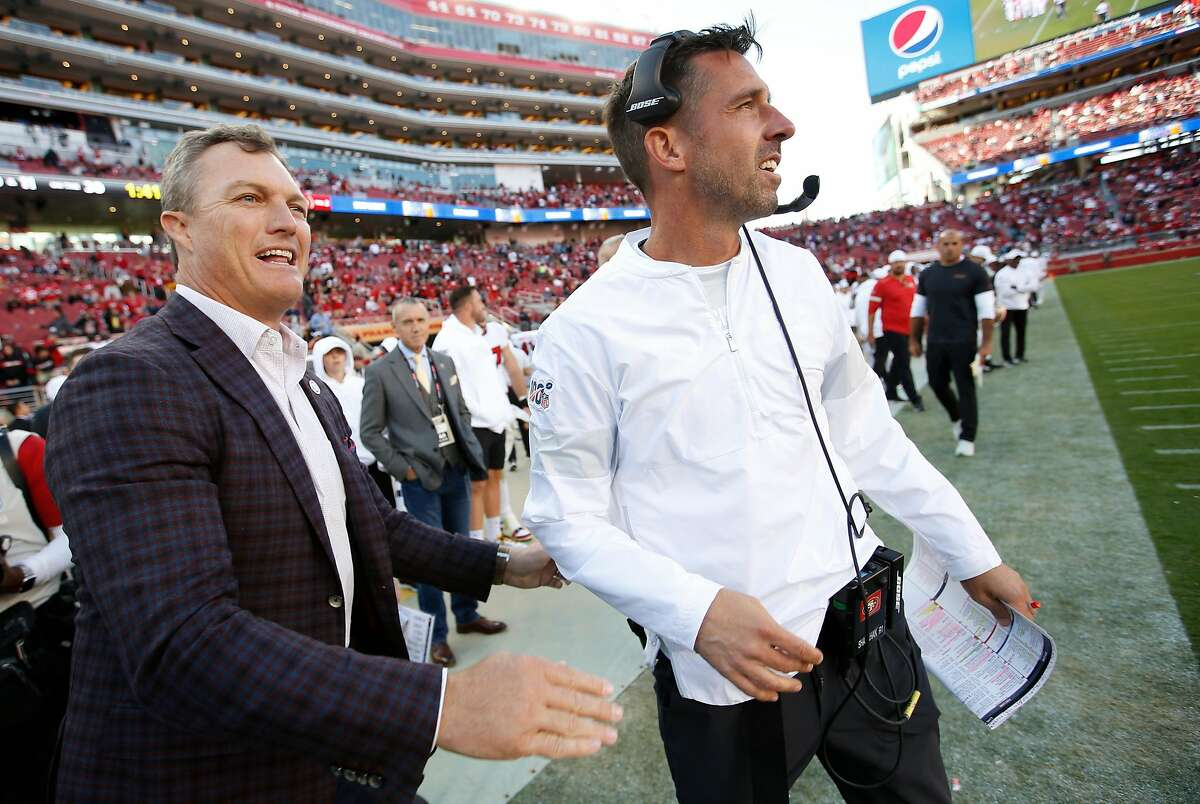SANTA CLARA, CA - OCTOBER 27: General Manager John Lynch of the San Francisco 49ers celebrates with Head Coach Kyle Shanahan on the sideline in the final minutes of the game against the Carolina Panthers at Levi's Stadium on October 27, 2019 in Santa Clara, California. The 49ers defeated the Panthers 51-13. (Photo by Michael Zagaris/San Francisco 49ers/Getty Images)