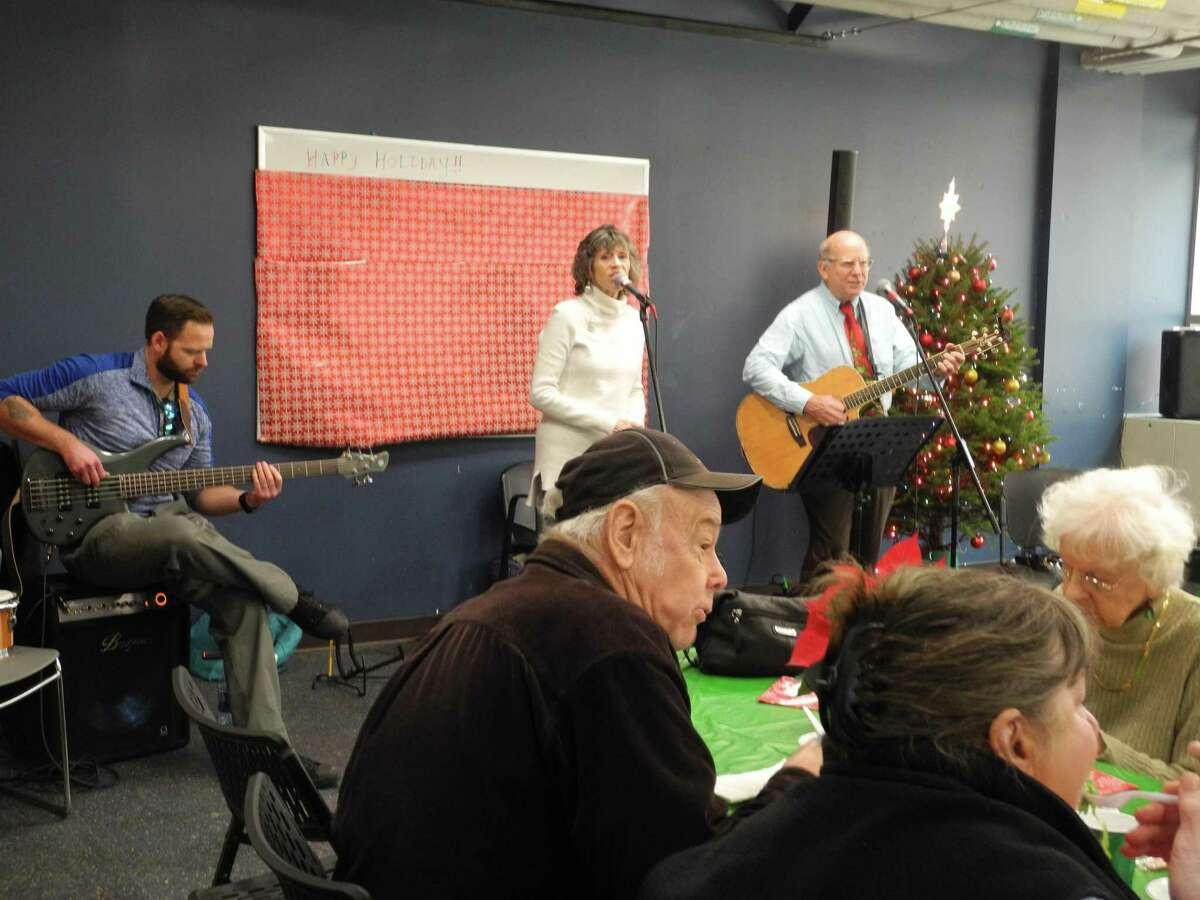 Kregg Zulkeski joins Willie and Jan Ninninger in entertaining at the Parks and Recreation Lunch Dec. 6.