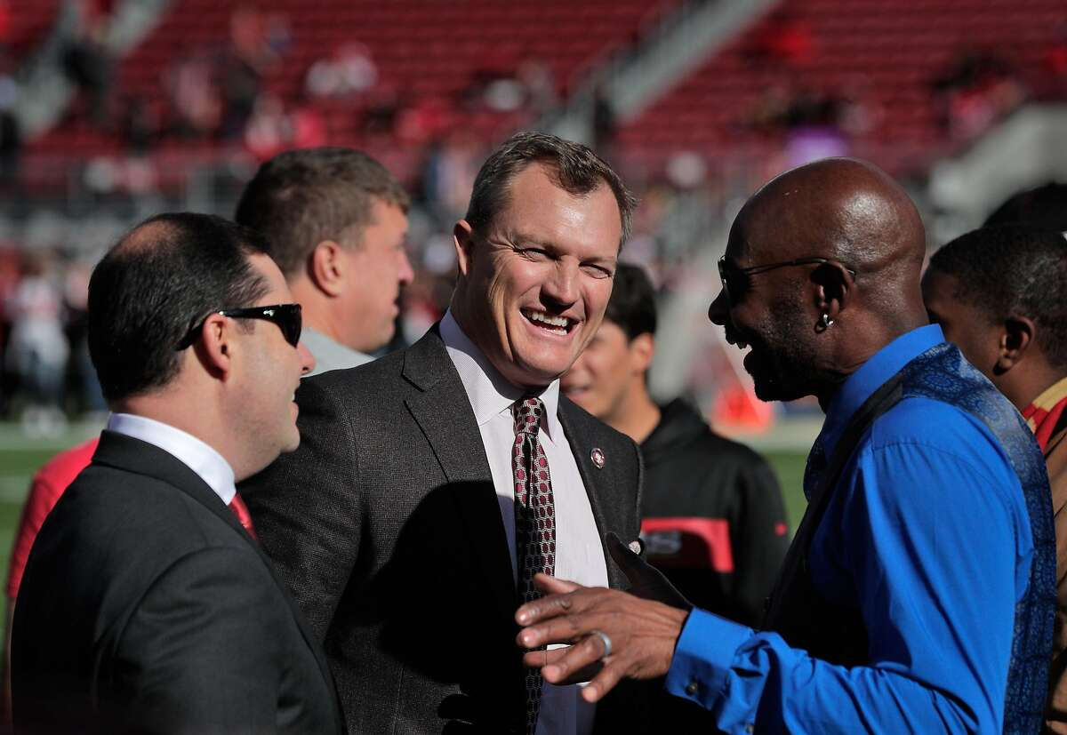 San Francisco 49ers general manager John Lynch, center, talks with Jerry Rice, right, and CEO Jed York, left, before the San Francisco 49ers play the Atlanta Falcons at Levi�s Stadium in Santa Clara, Calif., on Sunday, December 15, 2019.