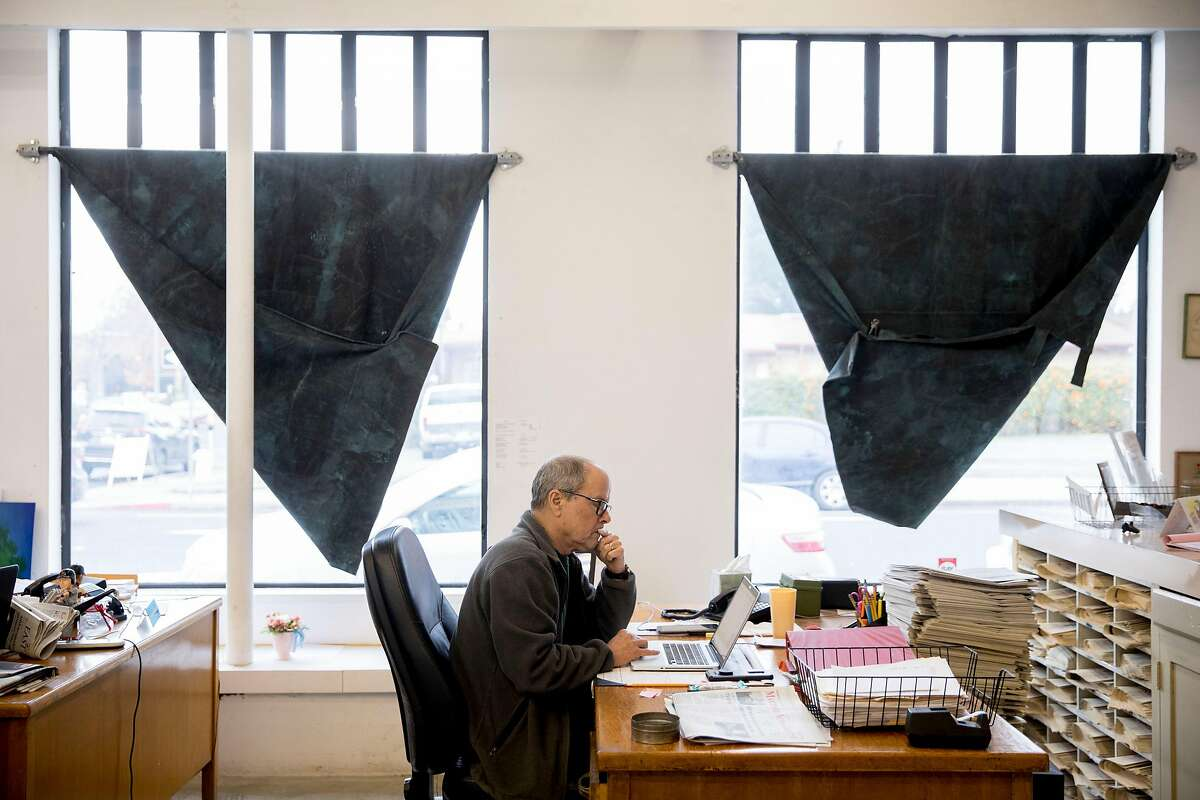 Business and circulation manager Robert Perry works at his desk during production time at the Martinez News-Gazette newsroom in Martinez, Calif. Friday, Dec. 13, 2019.