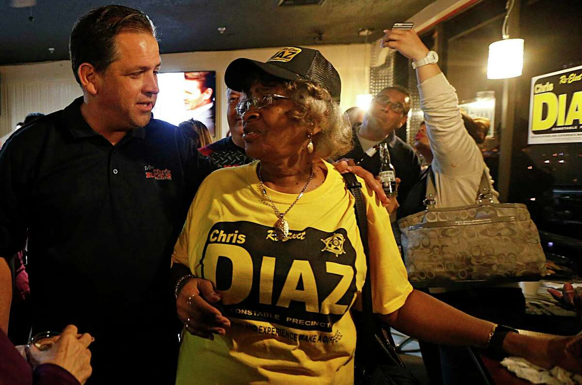 Harris County Precinct 2 Constable Chris Diaz left, speaks with Rubie Nelson right, while thanking supporters during his election night watch party at the Quality Inn hotel Tuesday, March 1, 2016, in Houston. ( James Nielsen / Houston Chronicle )
