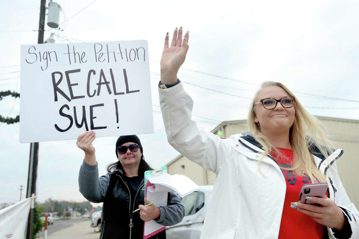 Alexandria Motes (at right), a three-year resident of Silsbee, is joined by supporter Dena Duprey, an Evadale resident and member of the group Voices for Justice, as she stands outside the Post Mart in Silsbee with a sign asking for signatures to recall city council member Sue Bard. Motes was inspired to start the recall campaign of Silsbee's city council, beginning with Bard, in light of citizen dissatisfaction with the council. Duprey says they met while attending city council meetings, and as Voices for Justice member