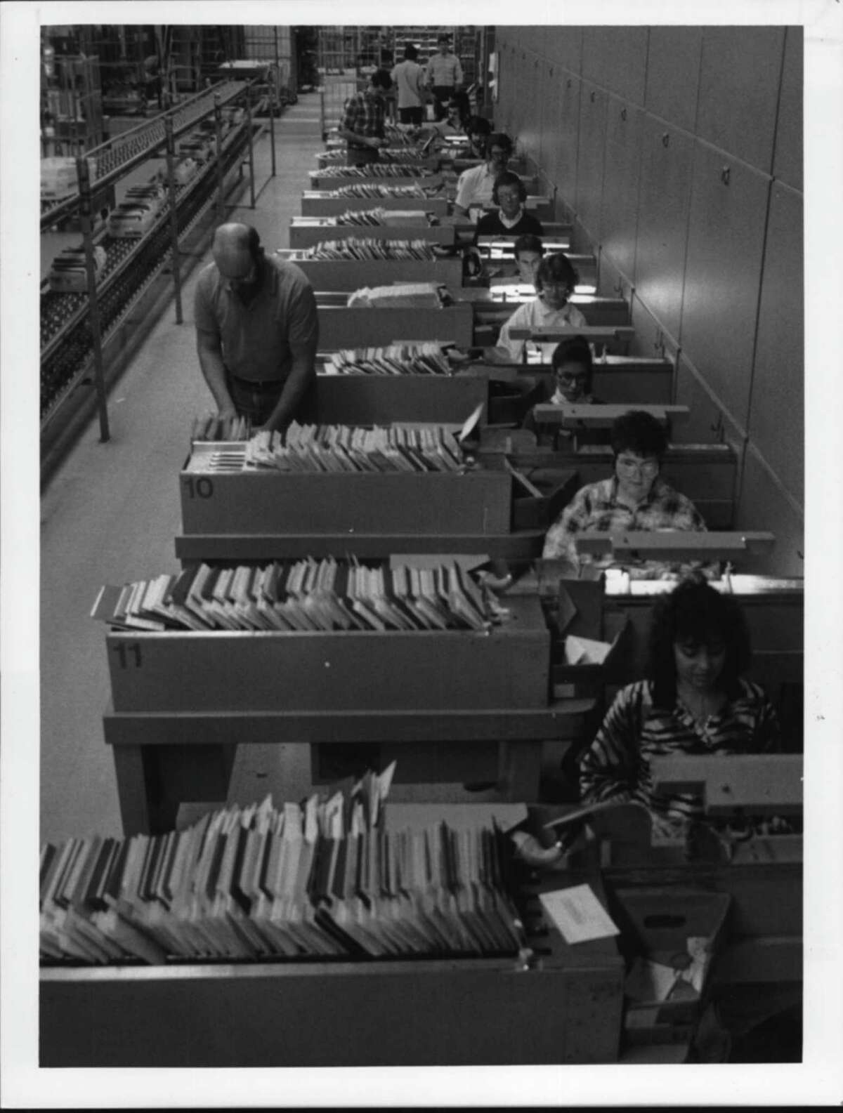 US Postal Service mail facility, Karner Road, Colonie, New York - postal workers sort flood of mail. December 21, 1987 (Jack Madigan/Times Union Archive)