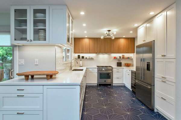 A vibrantly patterned floor accentuates this kitchen in Alameda designed by William Adams.