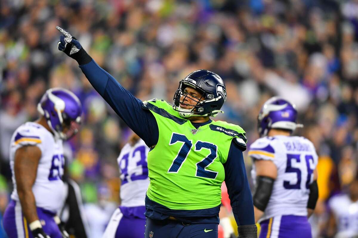 Veteran defensive tackle Al Woods has been suspended without pay for Seattle's next four games for violating the NFL's policy on performance-enhancing substances, the league announced Friday.
