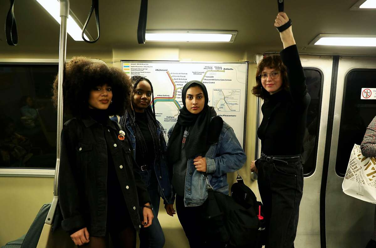 (Left to right) Mariah Tran, 20, a gender justice advocate, Uchenna Esomonu, 18, a gender justice advocate, Haleema Bharoocha, 21, advocacy manager, Alliance for Girls, and Itzel Sanchez, 21, organizing fellow, Alliance for Girls, pose for a portrait on a BART train in Oakland, Calif., on Thursday, December 19, 2019. BART met with the Alliance for Girls at the Betti Ono gallery near 12th street BART in Oakland on Dec. 16. It was a listening session, and opportunity to talk about the experiences of girls of color in the Bay Area. One hot topic: Girls of color don't feel safe on public transportation. Really, they don't feel safe in public, especially when they're walking to and from public transportation. More than a year after Nia Wilson was fatally stabbed on a BART platform, it seems like BART is making the prevention of harassment on public transportation a top priority.