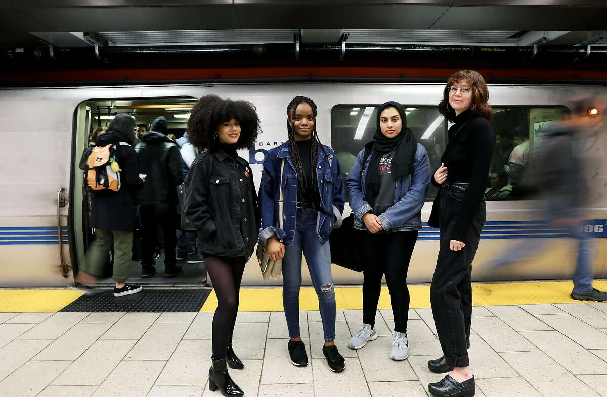 (Left to right) Mariah Tran, 20, a gender justice advocate, Uchenna Esomonu, 18, a gender justice advocate, Haleema Bharoocha, 21, advocacy manager, Alliance for Girls, and Itzel Sanchez, 21, organizing fellow, Alliance for Girls, pose for a portrait at the 12th Street BART Station in Oakland, Calif., on Thursday, December 19, 2019. BART met with the Alliance for Girls at the Betti Ono gallery near 12th street BART in Oakland on Dec. 16. It was a listening session, and opportunity to talk about the experiences of girls of color in the Bay Area. One hot topic: Girls of color don't feel safe on public transportation. Really, they don't feel safe in public, especially when they're walking to and from public transportation. More than a year after Nia Wilson was fatally stabbed on a BART platform, it seems like BART is making the prevention of harassment on public transportation a top priority.