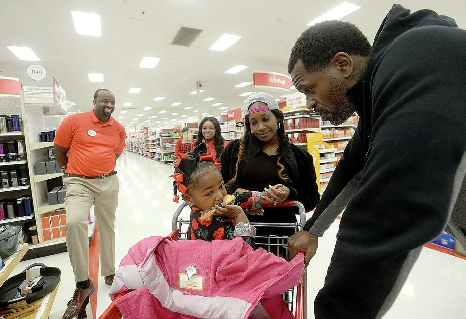 Stephen Jackson talks with DerrVonne LeBlanc as she and her mother Javonne Johnson arrive to join in the Christmas with a Champion event at Target Saturday. The Port Arthur native and former NBA champion donated gift cards to 100 families to purchase gifts for the holidays.  Photo taken Saturday, December 8, 2018  Kim Brent/The Enterprise Photo: Kim Brent / The Enterprise / BEN
