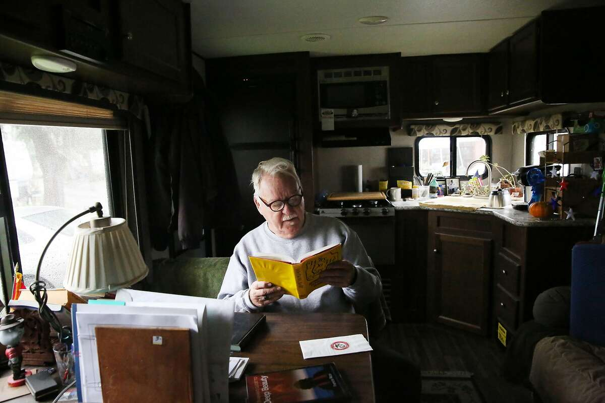 Bruce Voorhees reads a book after returning to his mobile home from errands on Wednesday, December 18, 2019 in Rohnert Park, Calif.