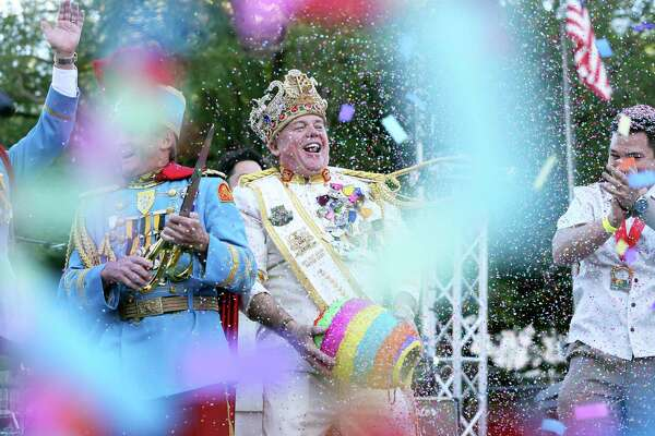 Rey Feo throws confetti from the big egg as the official opening of Fiesta 2016 in front of the Alamo on April 14, 2016 progresses toward nightfall.