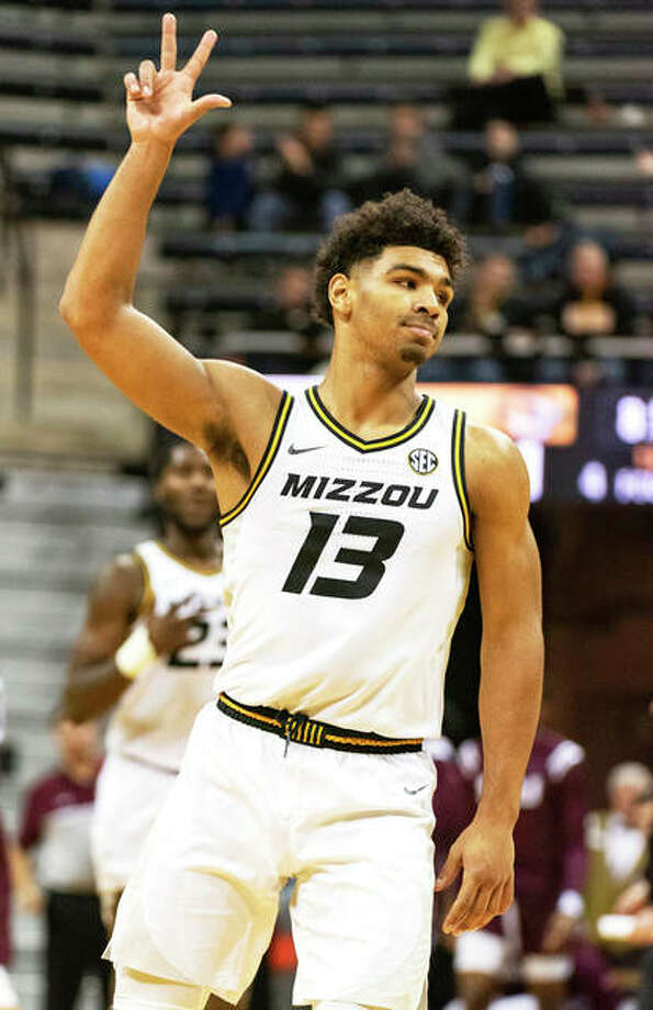 Missouri's Mark Smith reacts after one of his seven 3-pointers against Southern Illinois on Sunday in Columbia, Mo. Photo: Associated Press
