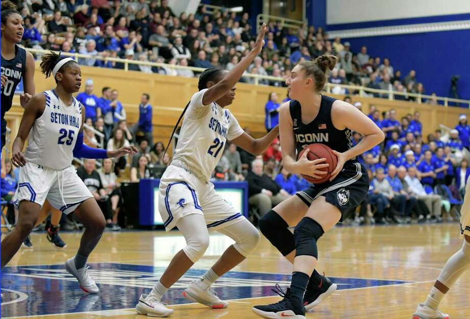 UConn guard Anna Makurat protects the ball from Seton Hall's Jasmine Smith (21) on Dec. 5. Photo: Bill Kostroun / Associated Press / Copyright 2019 The Associated Press. All rights reserved