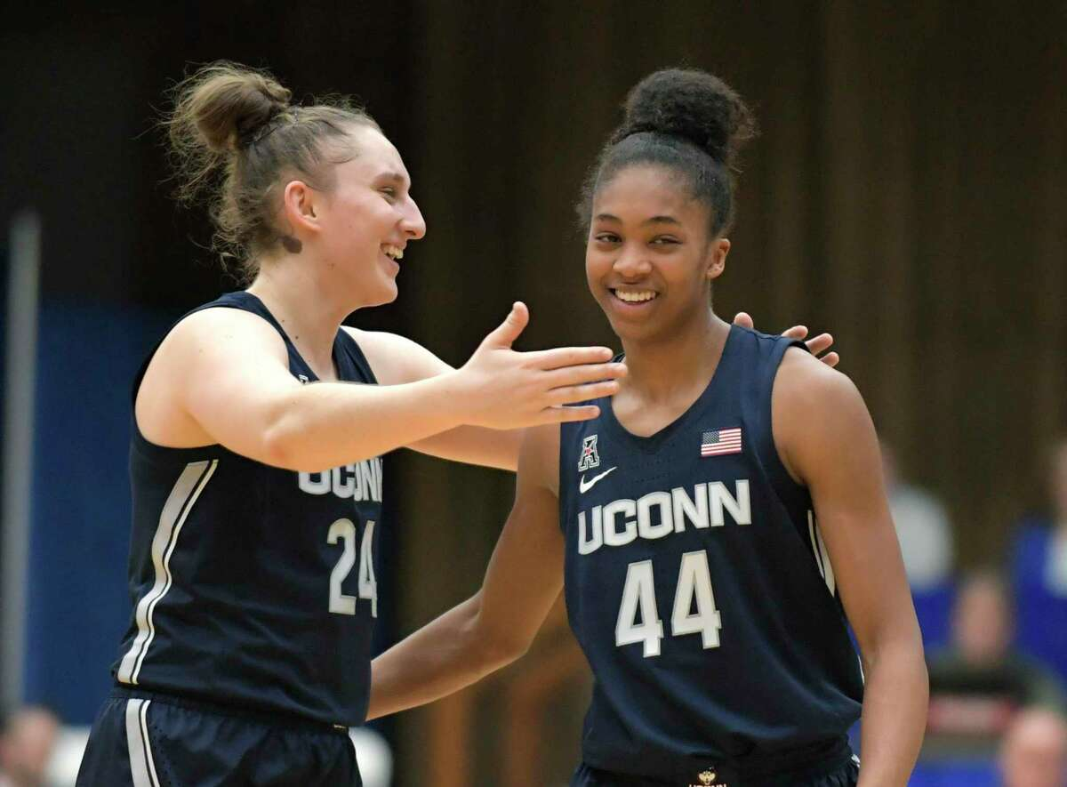 UConn guards Aubrey Griffin (44) and Anna Makurat (24) celebrate after defeating Seton Hall on Dec. 5.