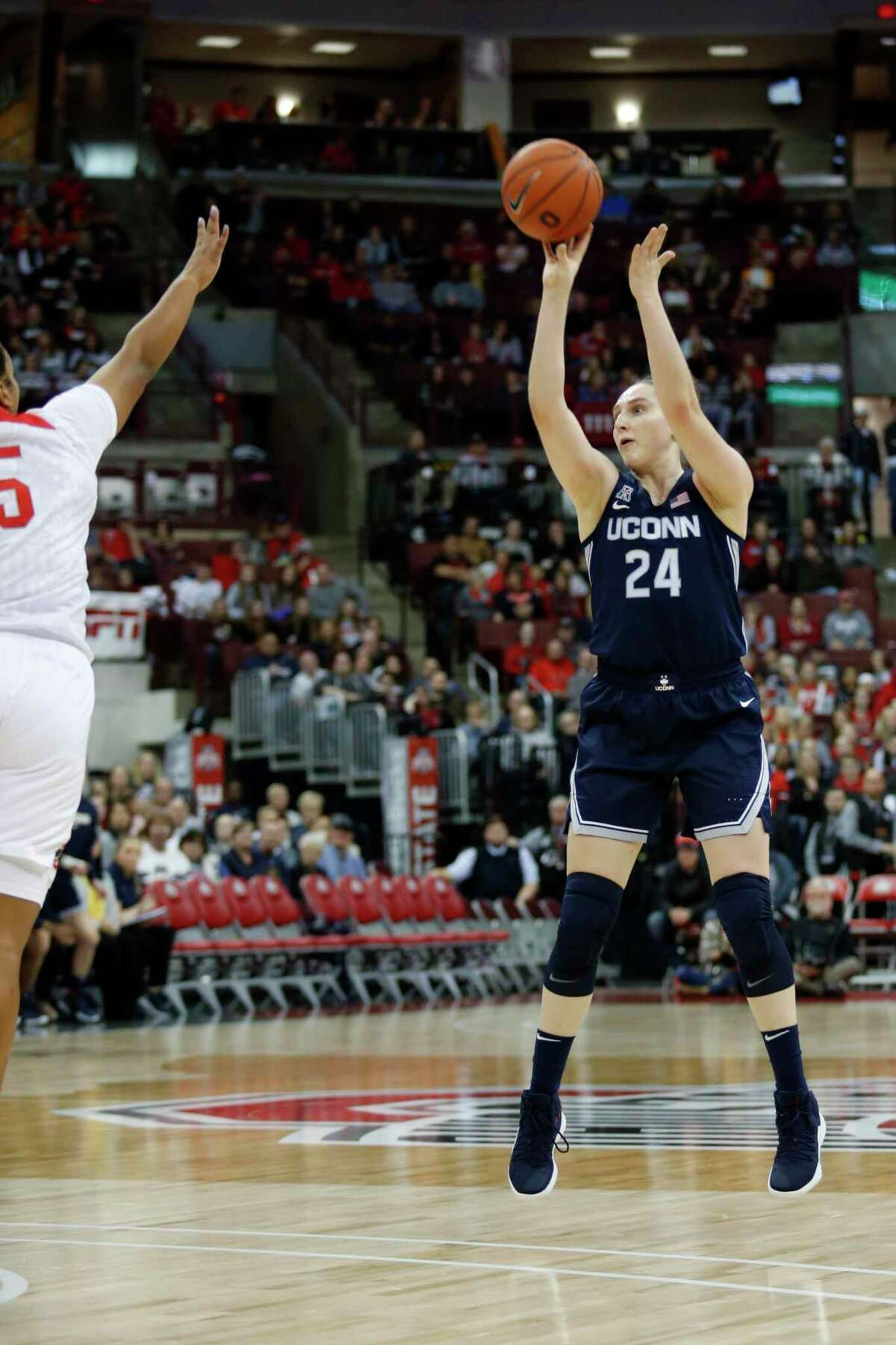 UConn guard Anna Makurat, right, goes up for a shot in front of Ohio State guard Kaelynn Satterfield on Nov. 24.