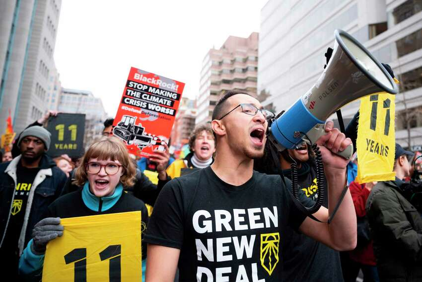 Demonstrators march during a rally to protest against climate change in Washington, DC, on December 6, 2019. (Photo by JIM WATSON / AFP) (Photo by JIM WATSON/AFP via Getty Images)