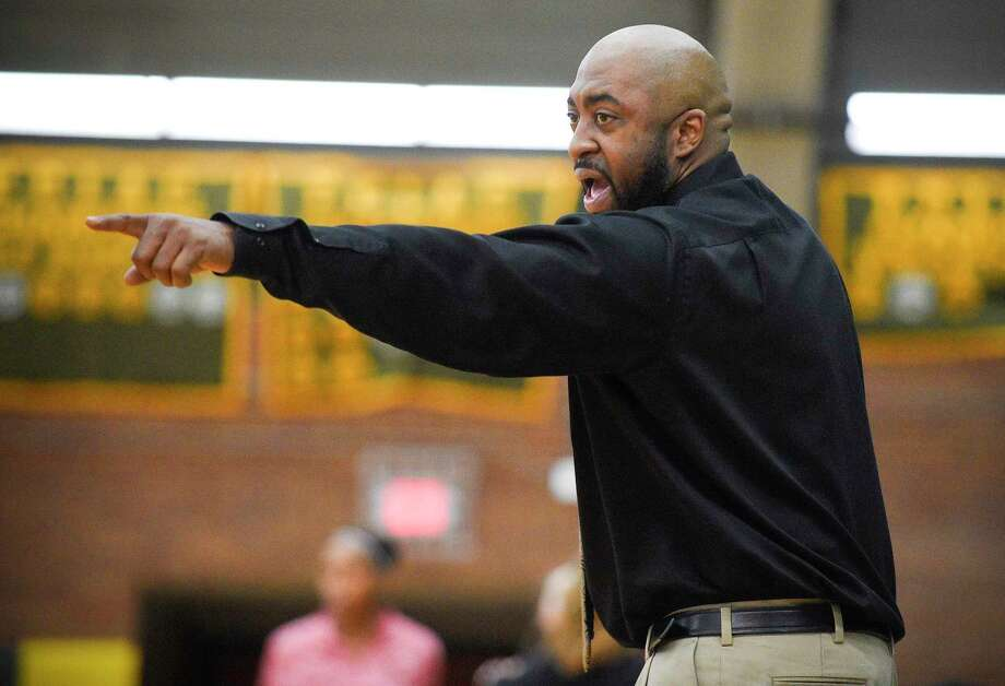 Trinity Catholic coach Charlie Miller shouts to his players the first half of the Lady Crusaders basketball season opener against Greenwich in Stamford, Conn. on Dec. 20, 2019. Greenwich won 57-45. Photo: Matthew Brown / Hearst Connecticut Media / Stamford Advocate