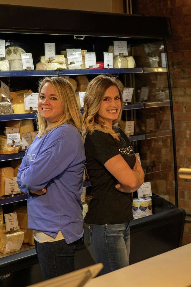 From left, sisters Lindsey Eberle of Middletown and Jamie Tomassetti of Hadlyme opened the Spread Cheese Co. boutique in early November at Main Street Market, 386 Main St., Middletown. These self-described foodies credit their father's influence for fostering their love of cheese, which began when they were young. Photo: S & Company Portrait Photography