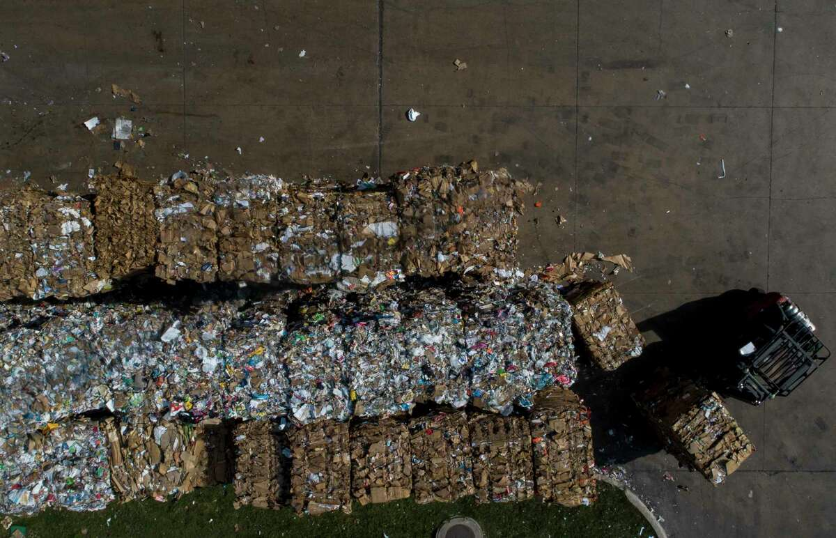 Bundles of sorted paper and cardboard are grouped together at the Balcones Resources recycling center Monday, Dec. 9, 2019, in Austin, Texas.