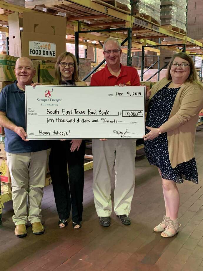 Representatives from Sempra Energy awarded the Southeast Texas Food Bank in Beaumont a $10,000 grant as a part of its holiday giving initiative across Texas. Photo: Courtesy Of Sempra Energy