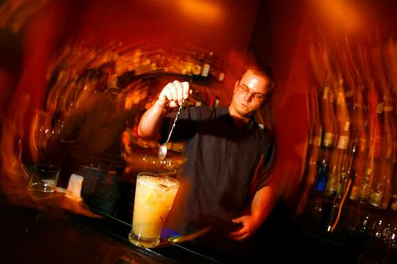 Aaron Prentice, owner of Cantina (580 Sutter) prepares a pitcher of pisco punch.