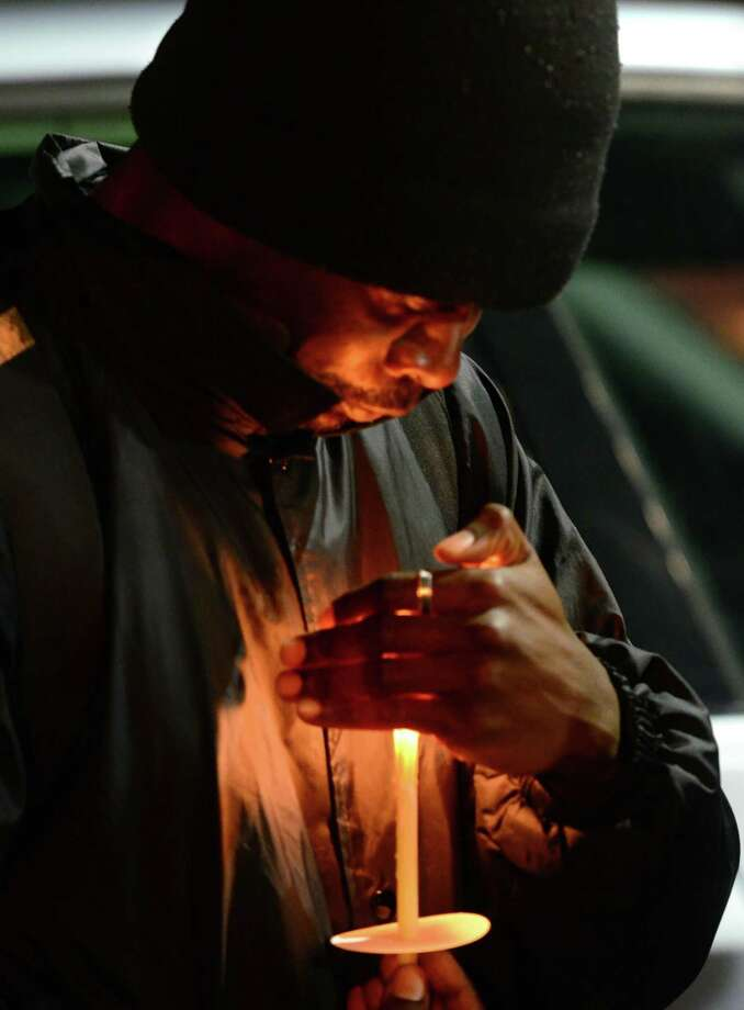 Open Doors client Donald Rose holds a candle during a Homeless Persons' Memorial Day Candlelight Remeberance Vigil held at Smilow Life Center in Norwalk, Conn., on Friday Dec. 20, 2019. The vigil was held to remember five homeless people who've died in 2019. Photo: Christian Abraham / Hearst Connecticut Media / Connecticut Post