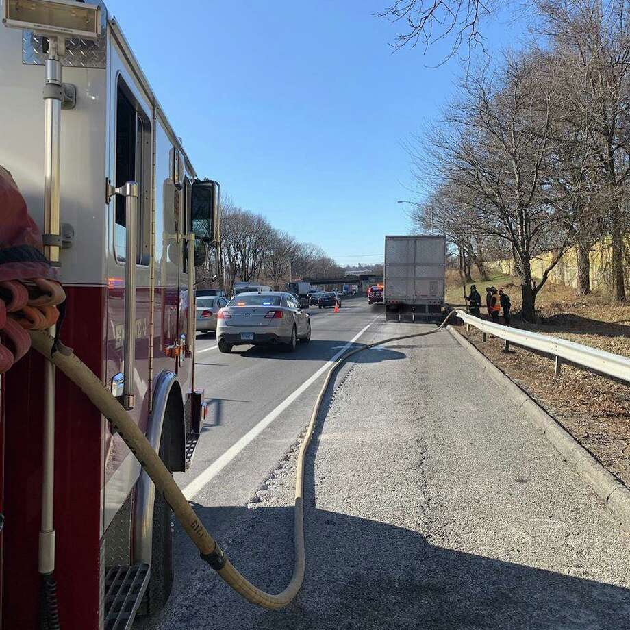 Firefighters extinguish a fire caused by overheated tractor trailer brakes on Dec. 20, 2019. Photo: Contributed Photo / Westport Fire Department