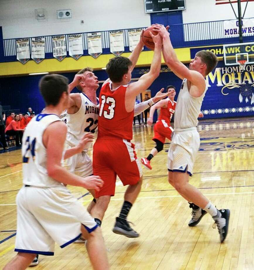 Morley Stanwood's Aiden McLaughlin and Ryland Nelson fight for control of the ball during their team's win over Holton on Friday night. (Pioneer photo/Joe Judd)