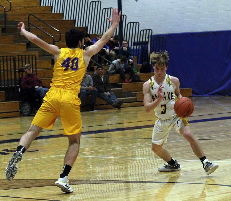 The Bad Axe boys basketball team improved to 4-0 after beating visiting Caro, 47-34, on Friday night. Photo: Mark Birdsall/Huron Daily Tribune
