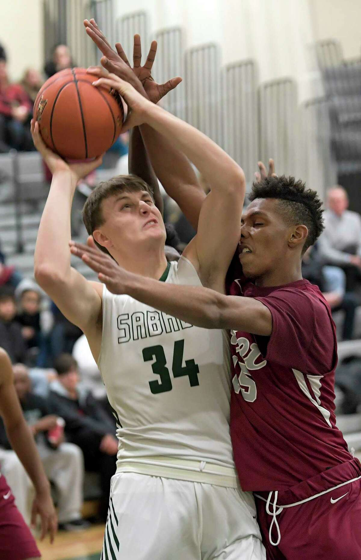 Schalmont's Shane O'Dell (34) is defended by Watervliet's Jadon Dickson (15) during the first half of a Section II boys' basketball game Friday, Dec. 20, 2019, in Rotterdam, N.Y. (Hans Pennink / Special to the Times Union) ORG XMIT: 122119_hsbb_HP102