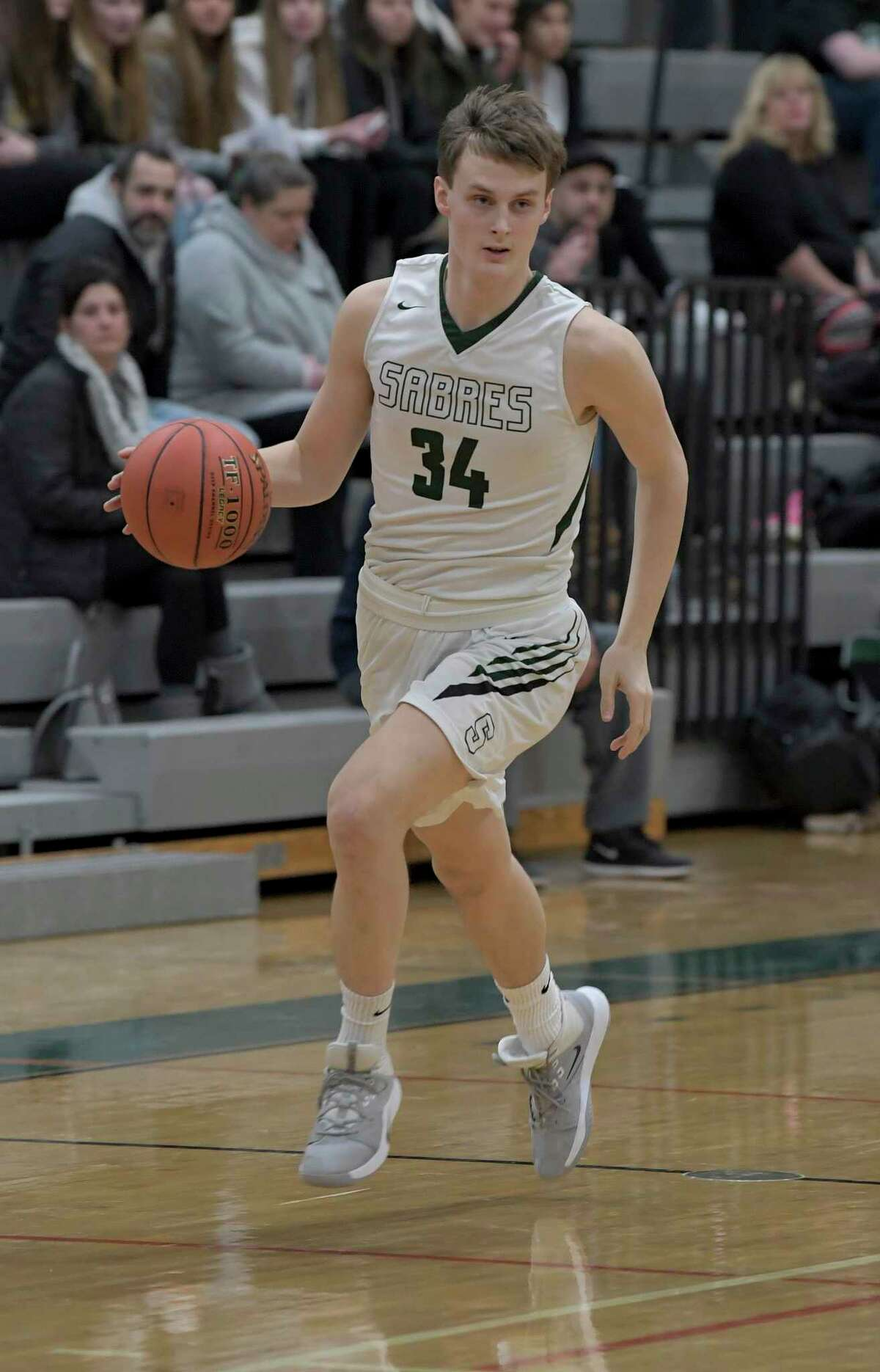 Schalmont's Shane O'Dell (34) moves the ball against Watervliet during the first half of a Section II boys' basketball game Friday, Dec. 20, 2019, in Rotterdam, N.Y. (Hans Pennink / Special to the Times Union) ORG XMIT: 122119_hsbb_HP103