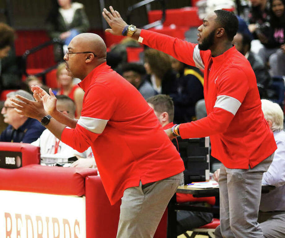 Alton coach Dana Morgan (left) and assistant Aaron Womack direct traffic during the Redbirds' Southwestern Conference boys basketball game against O'Fallon on Dec. 10 at Alton High in Godfrey. The Redbirds were back in SWC action Friday night at Collinsville. Photo: Greg Shashack / The Telegraph