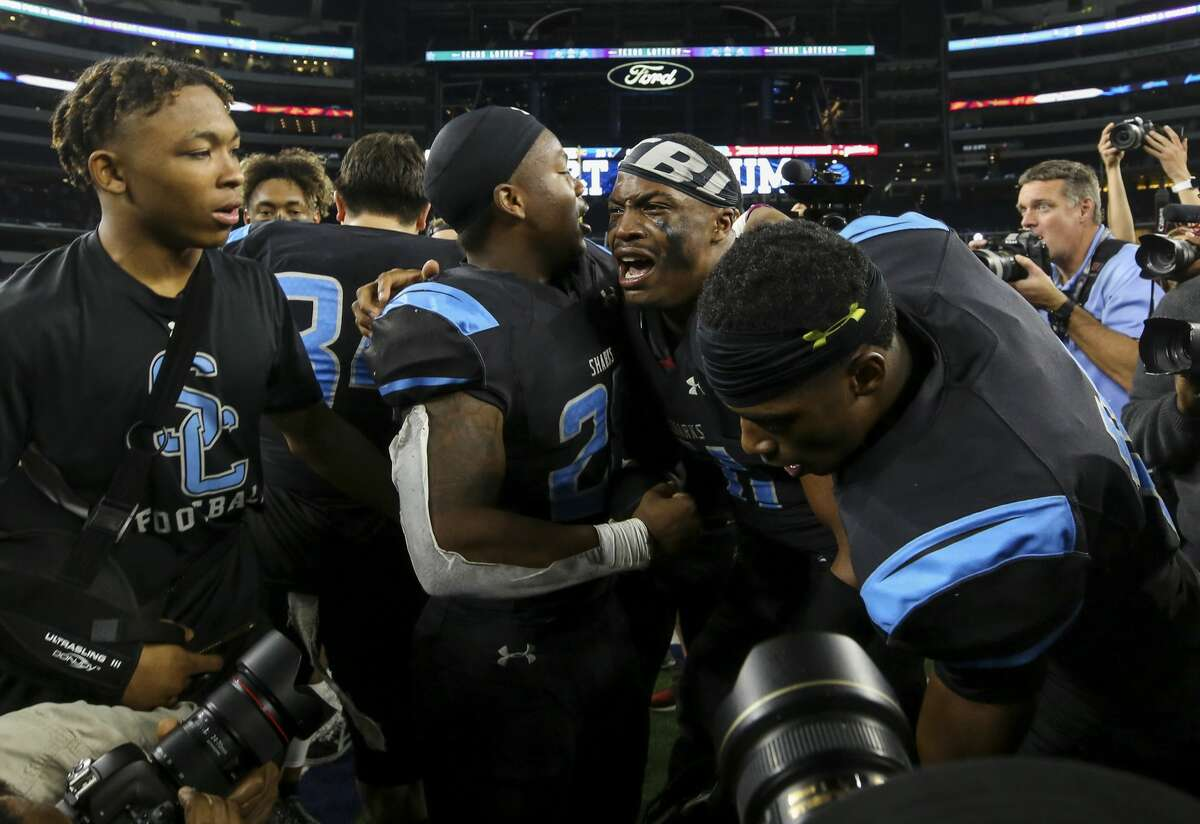 The Shadow Creek football team celebrates after winning the UIL 5A Division 1 State Championship Friday, Dec. 20, 2019, in Arlington, Texas.