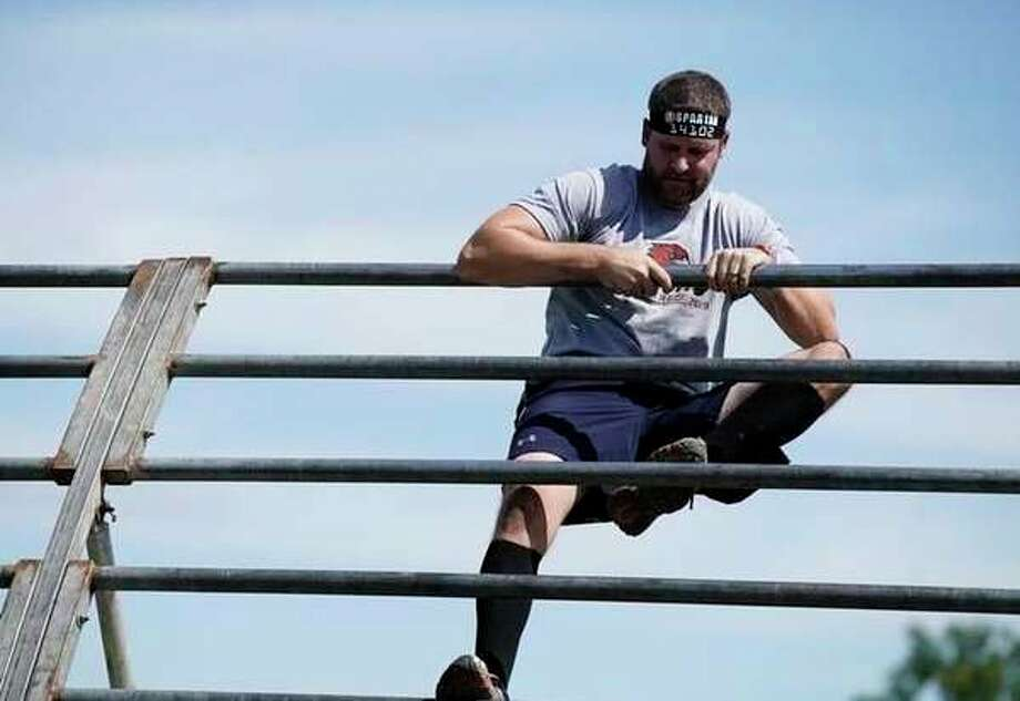 The recent Spartan Race in Brooklyn Michigan was 8-miles long and had 29 obstacles that included climbing, crawling under barbwire and more. (Courtesy photo)