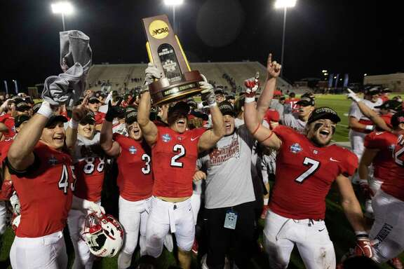North Central College celebrates after defeating Wisconsin-Whitewater 41-14 to win the NCAA Division III college football championship at Woodforest Bank Stadium, Friday, Dec. 20, 2019, in Shenandoah.