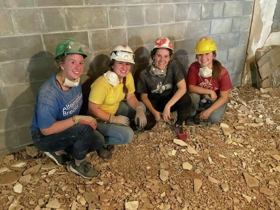 SVSU students this week volunteering by rebuilding, repairing and beautifying homes for disadvantaged homeowners in New Orleans.From left: Breanna Summers, a nursing major from Auburn; Mary Brege, an elementary education major from Rogers City; Raegan Schultz, a public administration/psychology major from Saginaw; and Lindsey Mead, an English major from Saginaw. (Photo provided)
