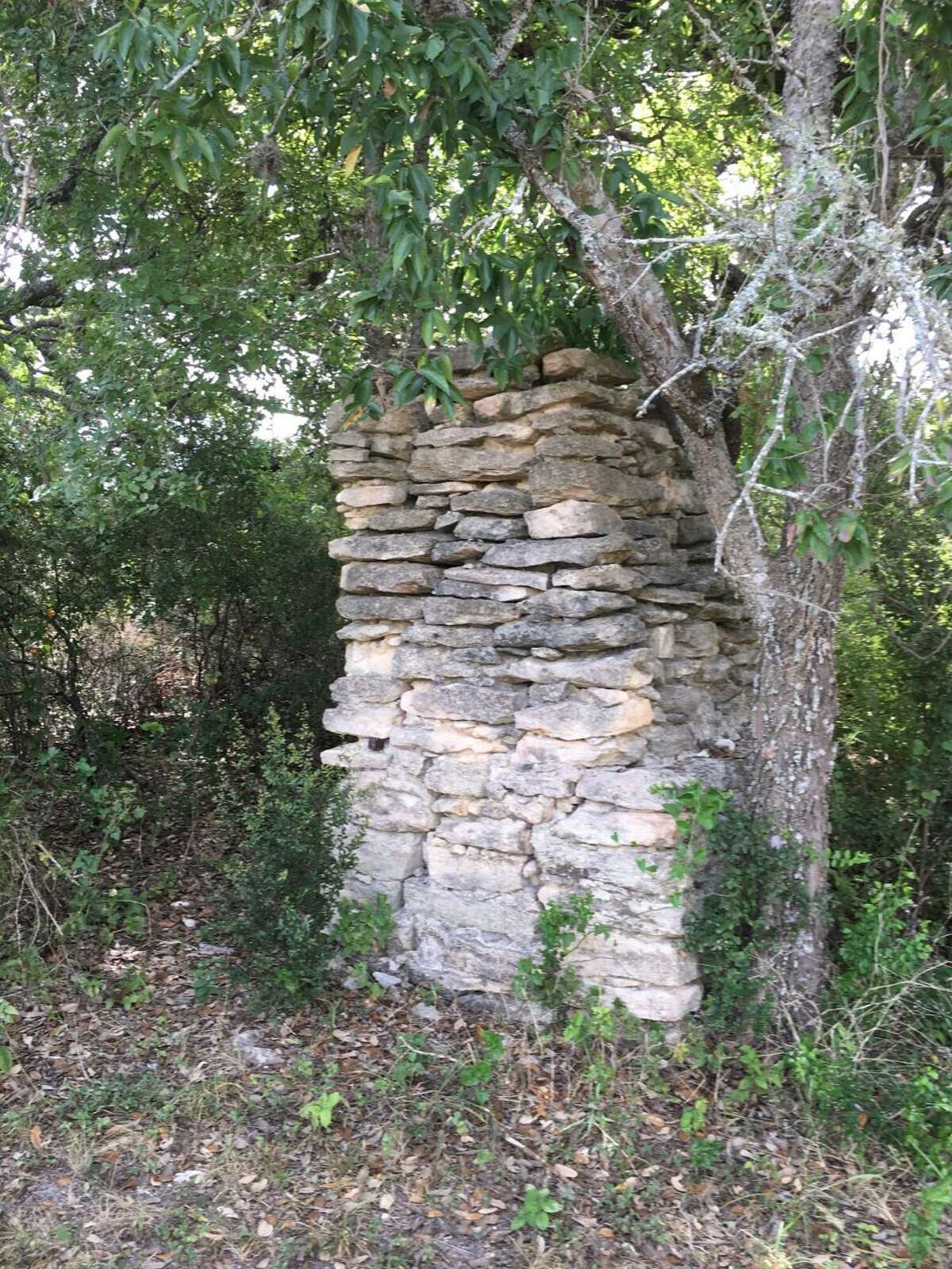 The remains of a stone chimney still standing near the Padilla-Zimmerle family cemetery at the Redbird Ranch subdivision appears to have been part of a now-missing structure, probably a wood homestead belonging to the family.