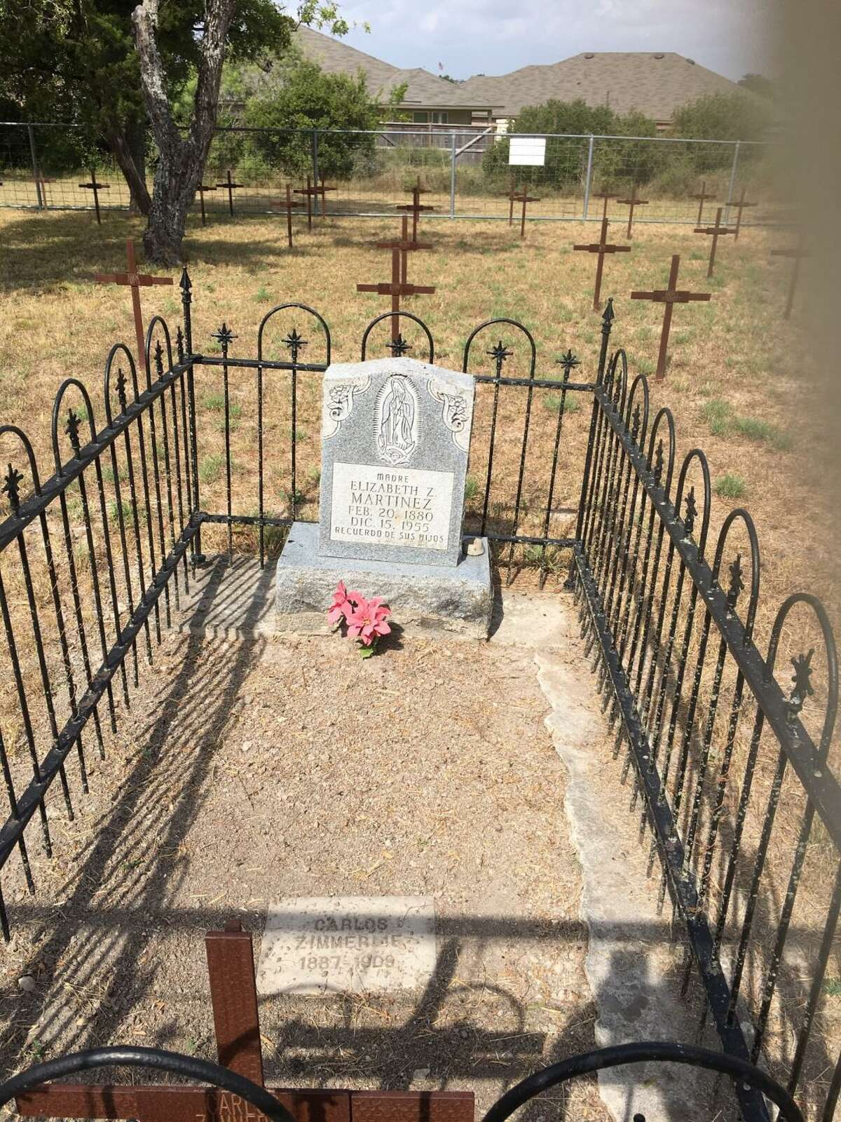 This marker shows the grave of Elizabeth Zimmerle Martinez (1880-1955), one of more than 60 known individuals buried in the Padilla-Zimmerle family cemetery preserved at the Redbird Ranch Subdivision.