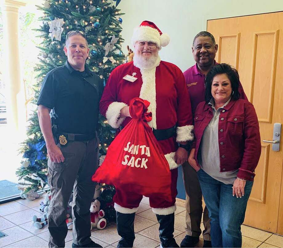 Santa Clause dropping of some toys to Cleveland Chief of Police Darrel Broussard Photo: Contributed Photo