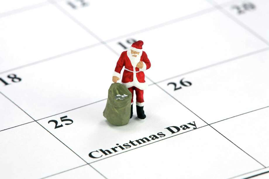 Miniature Santa Claus standing on a calendar with Christmas Day printed on it. Photo: Amy Walters / handout