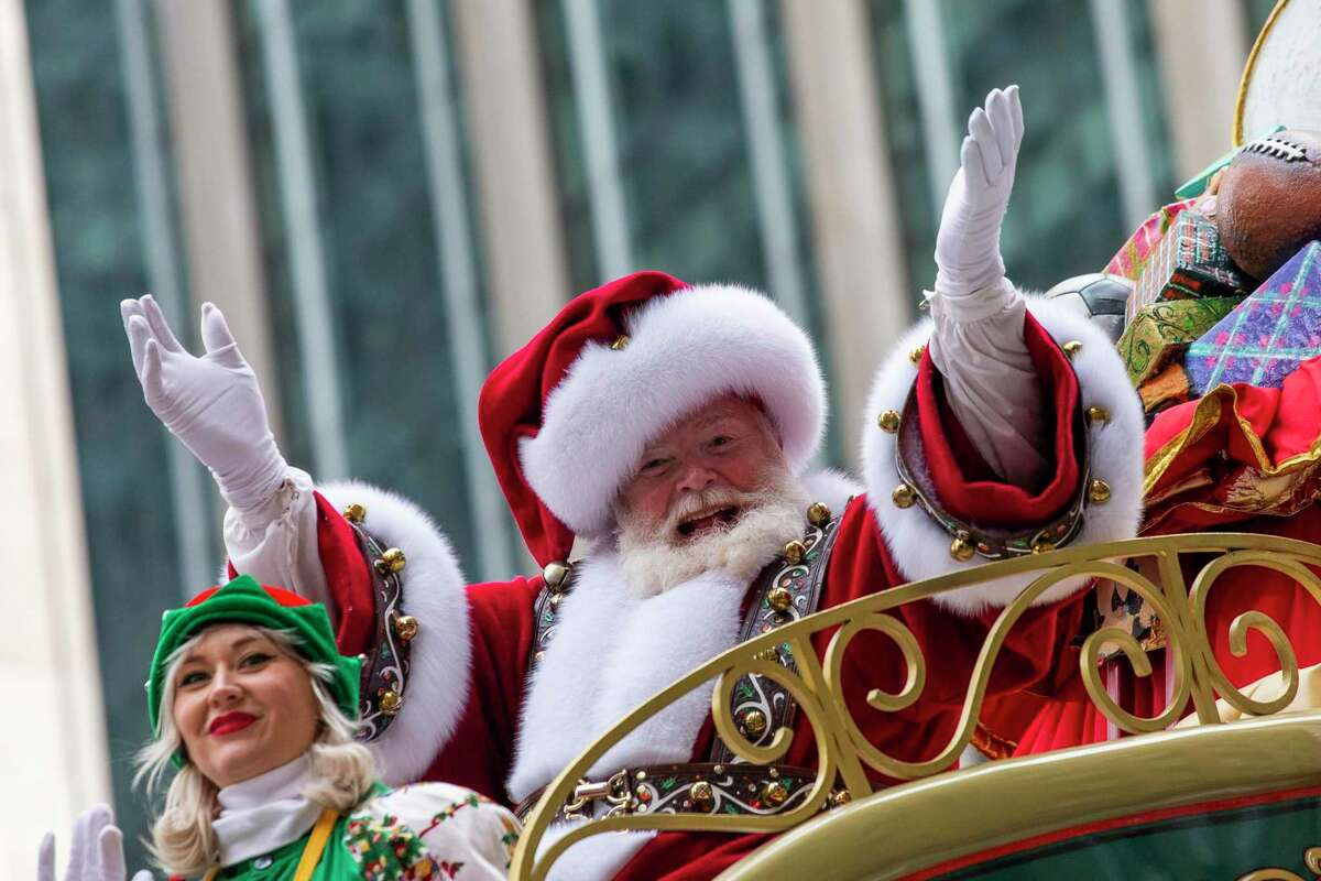 Santa Claus waves in front of Radio City Music Hall on Sixth Avenue during the Macy's Thanksgiving Day Parade, Thursday, Nov. 28, 2019, in New York.