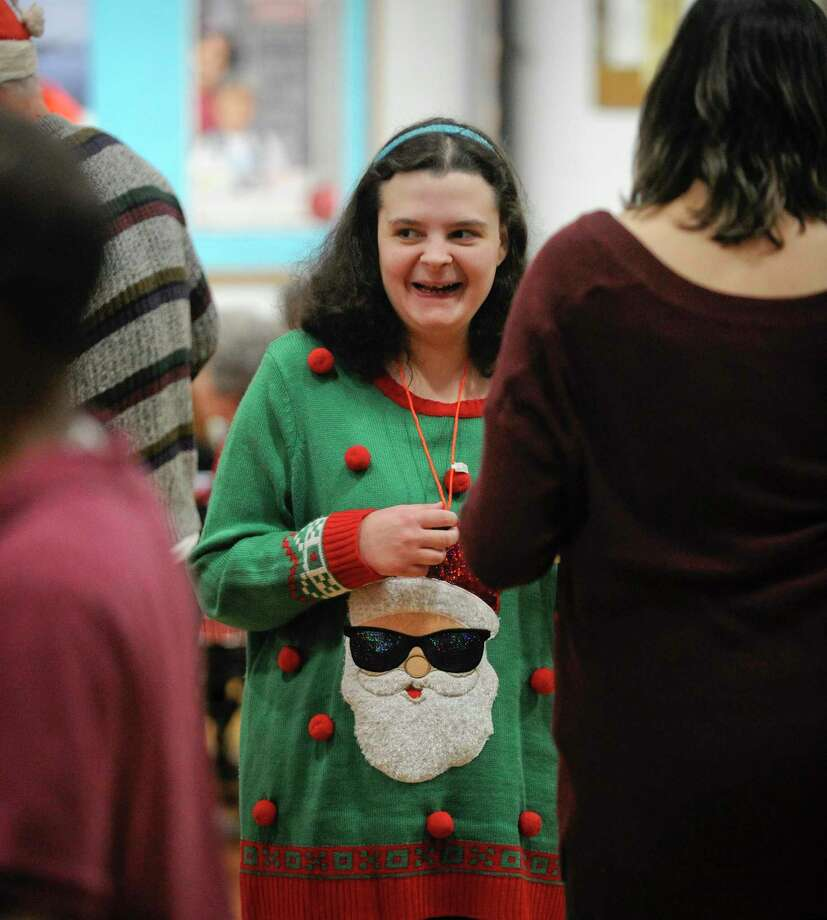 Melanie Luchetta enjoys the music during the Abilis annual holiday dance in Greenwich, Conn. on Dec. 18, 2019. Guests were treated to a holiday meal of Chicken nuggets, Mac and Cheese, Baked Ziti, salad and desserts from Cos Cobs Chicken Joes while enjoy music provided by DJ Cool Gee. The non-profit organization that provides services and supports for over 700 individuals with special needs and their families from birth through the life span. Abilis has been a leader in serving the special needs community in lower Fairfield County for 68 years and has a long-standing reputation for high quality care. Photo: Matthew Brown / Hearst Connecticut Media / Stamford Advocate