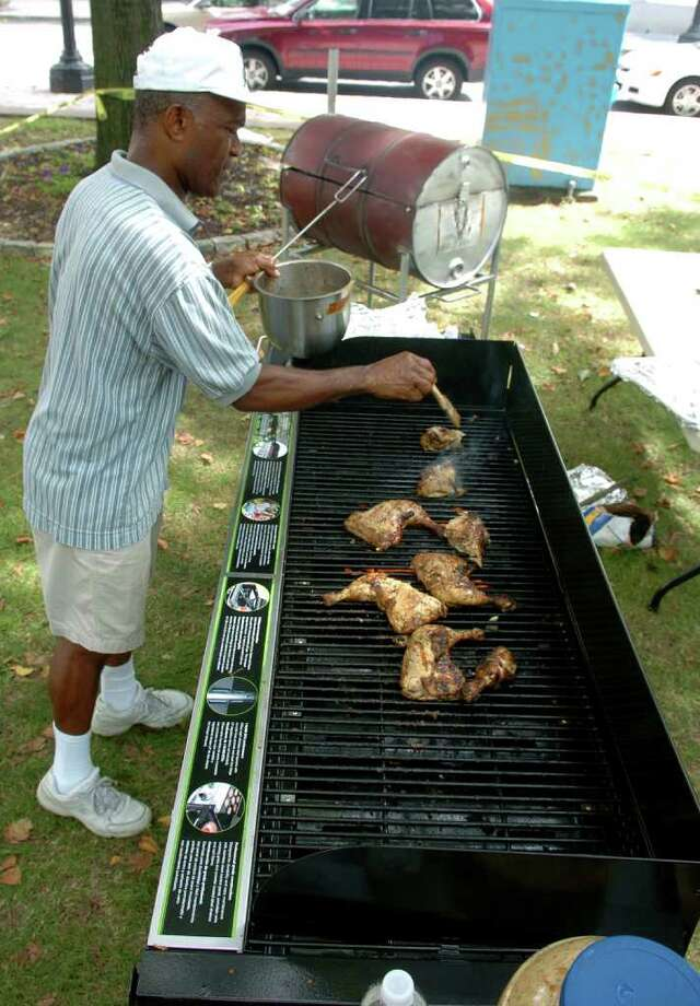 Headley Carter, of the West Indian American Association of Greater Bridgeport, cooks up some jerk chicken, during the Caribbean Jerk Fest on McLevy Green in downtown Bridgeport, CT on Saturday Aug. 22, 2009. Photo: Christian Abraham / Connecticut Post