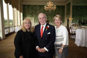 John Daughtery, flanked by Anne Incorvia, executive vice president, left, and Cheri Fama, president and COO.