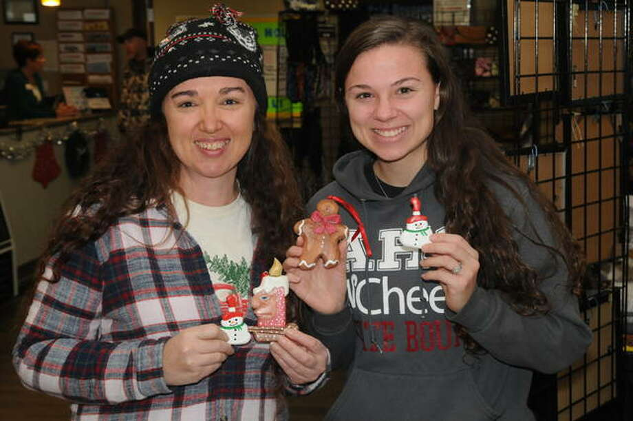 Mother and daughter Julia Frazier of Godfrey and Rileigh Griffin of Alton purchase identical Christmas ornaments at Saturday's Winter Market at SSP in Alton.