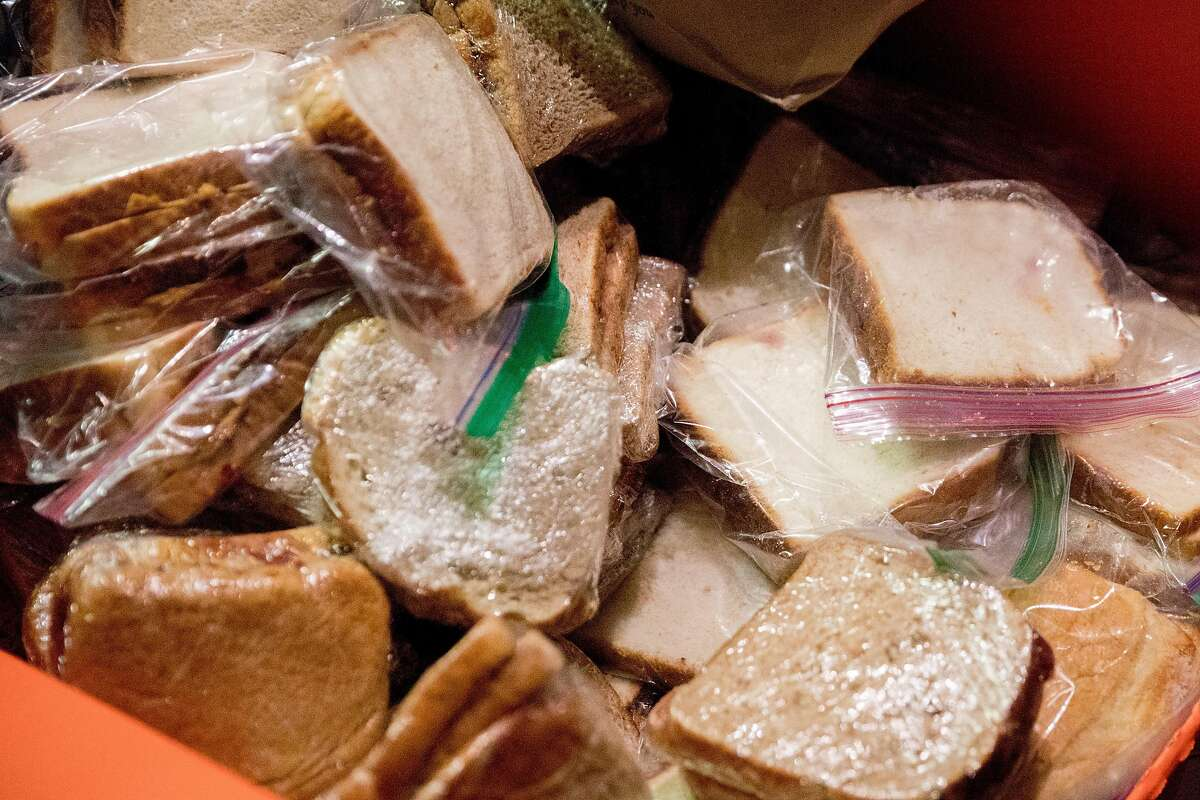 A box of peanut butter and jelly sandwiches sit on a table as families from Lafayette, Hillsborough and San Mateo work to build lunches and care packages for the homeless while at Piano Fight in the Tenderloin neighborhood of San Francisco, Calif. Saturday, December 21, 2019.
