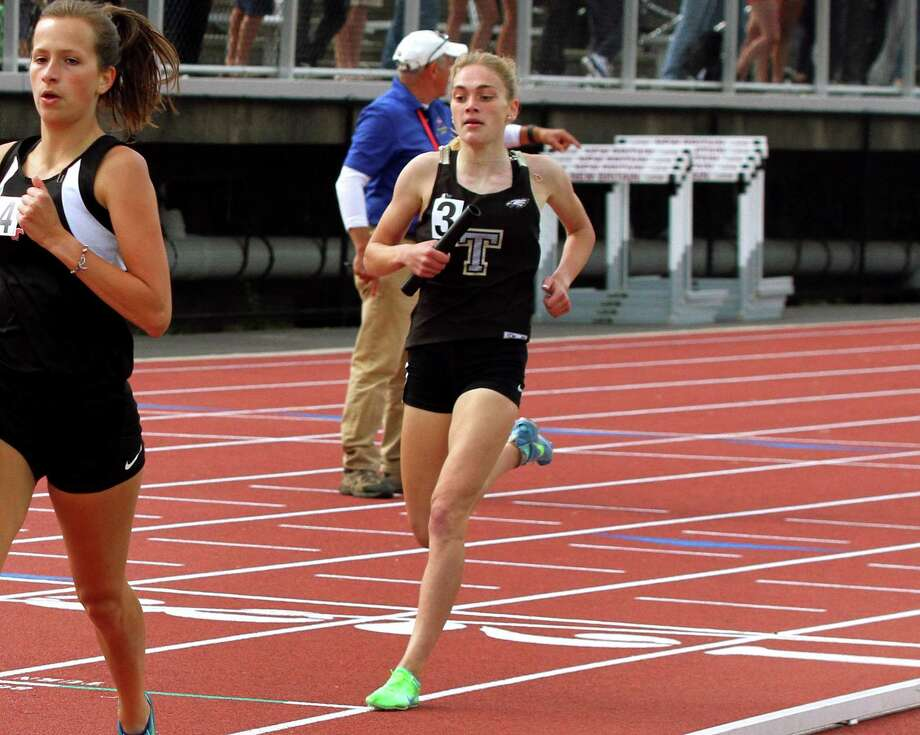 Trumbull's Emily Alexandru cross the finish in the girls 4X800 relay during Class LL Track and Field Championship action in New Britain, Conn., on Wednesday May 29, 2019. Photo: Christian Abraham / Hearst Connecticut Media / Connecticut Post