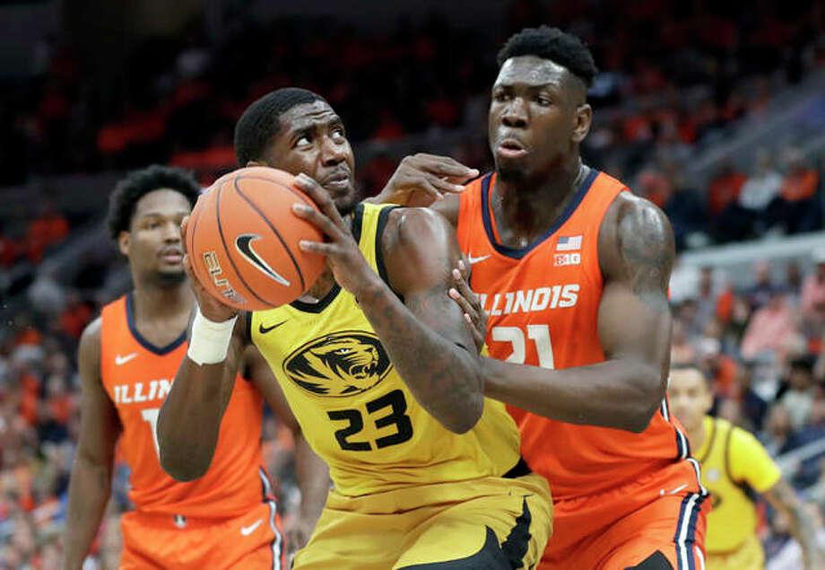 Missouri's Jeremiah Tilmon (23) looks to the basket as Illinois' Kofi Cockburn (right) defends during the second half of the Braggin' Right game Saturday in St. Louis. Missouri won 63-56. Photo: Associated Press